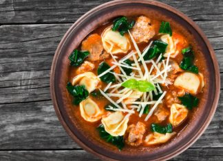 tortellini soup with spinach in a bowl