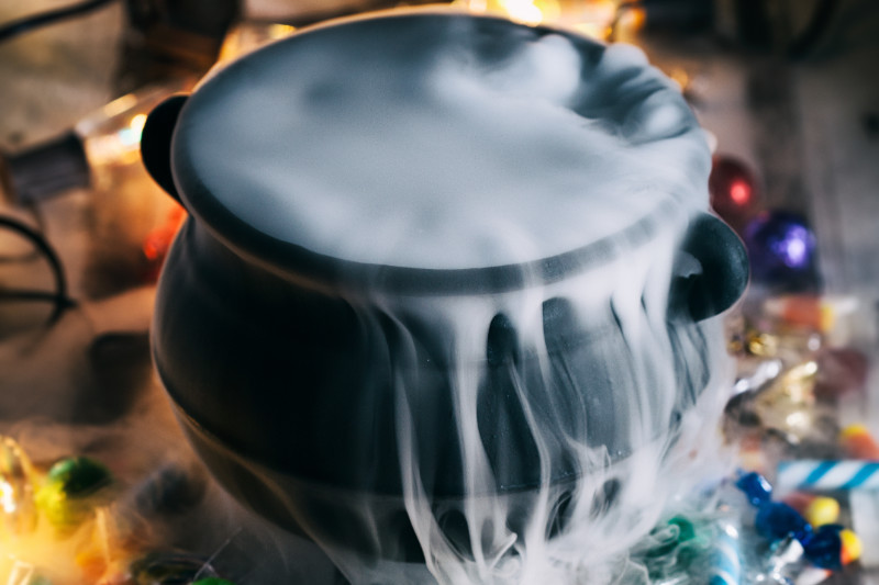 witches brew green punch in a cauldron with dry ice