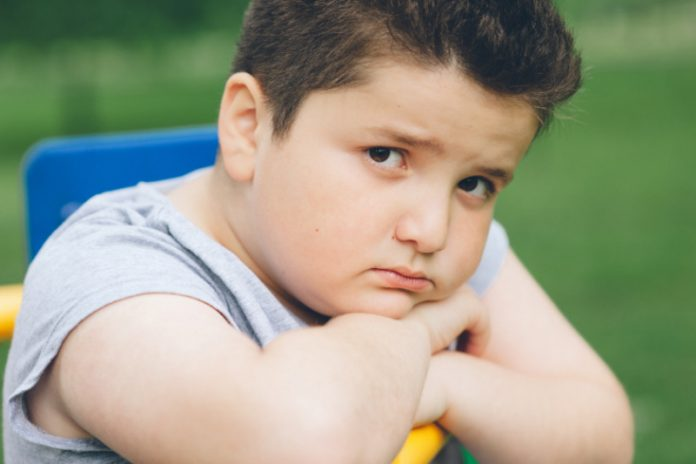 How to Boost Your Child's Self-Esteem If They're Struggling With Obesity