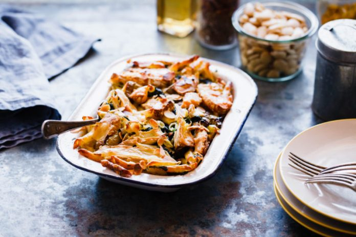 Sausage and Kale Baked Pasta in a casserole dish
