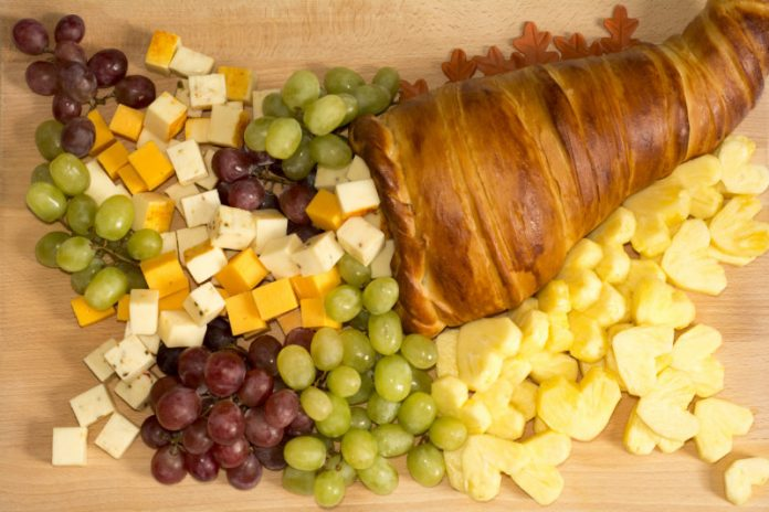 bread cornucopia filled with fruit and cheese