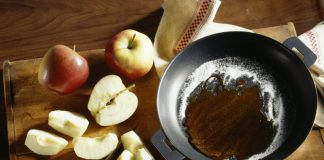 cinnamon apples in a skillet with caramel