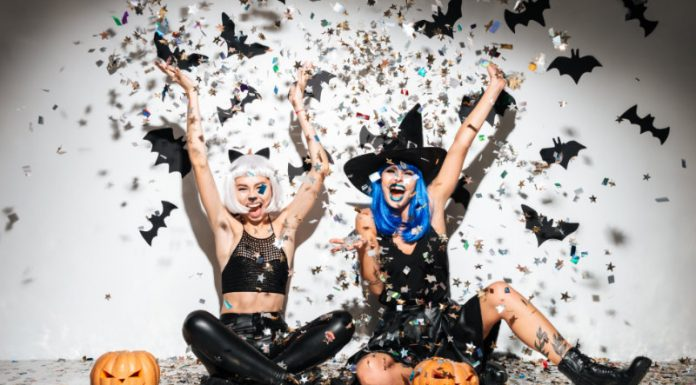 women dressed up in DIY costumes throwing confetti