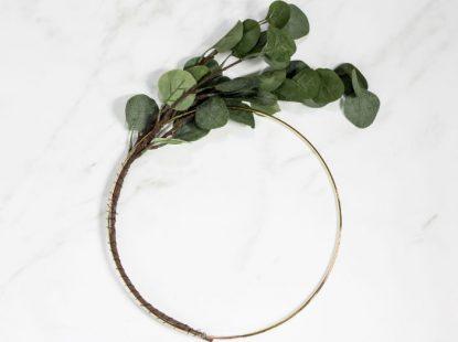wrap a eucalyptus stem around gold ring