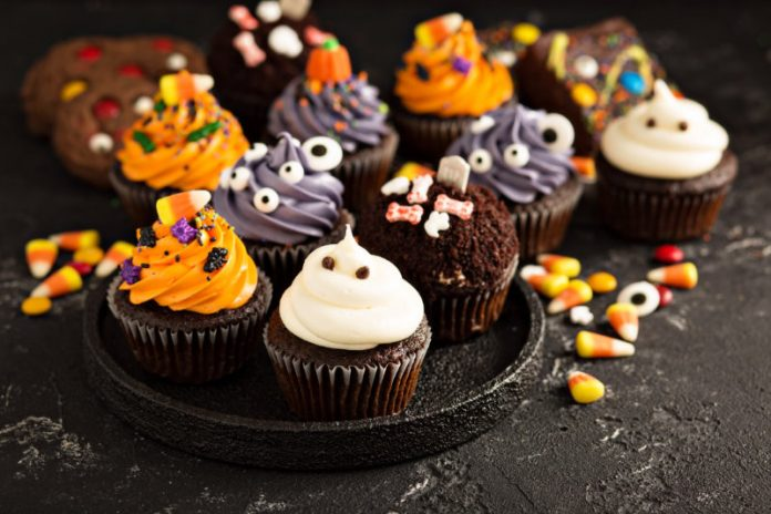 assorted halloween cupcakes on a plate