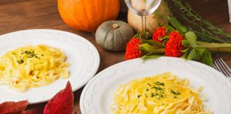 pumpkin fettuccini alfredo pasta on two plates