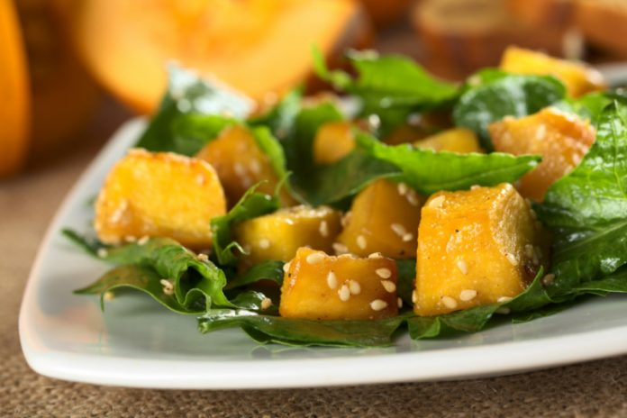 pumpkin salad with sesame seeds on a plate