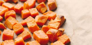 cinnamon roasted sweet potatoes on a baking sheet