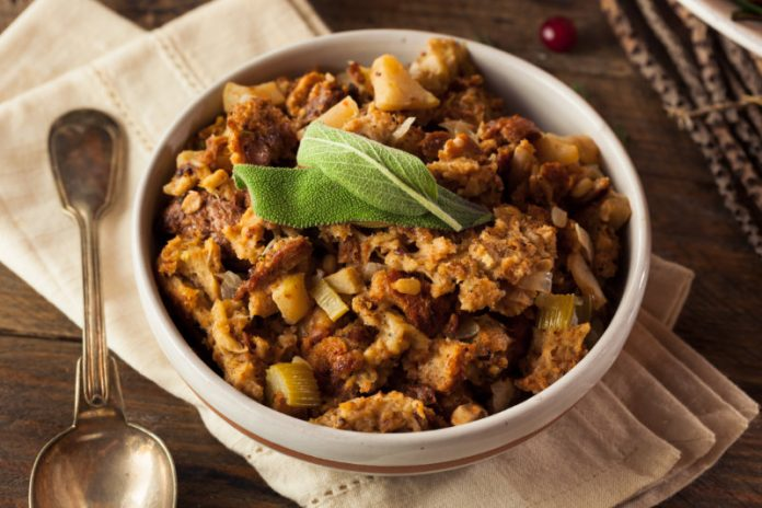 sausage and herb stuffing with sage on top in a dish