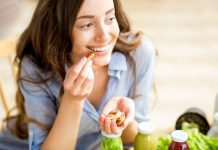 woman snacking on healthy nuts