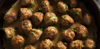 Swedish meatballs in a pan with cream sauce and parsley