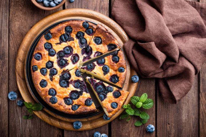 Healthy Coffee Cake with Blueberries on a wooden board