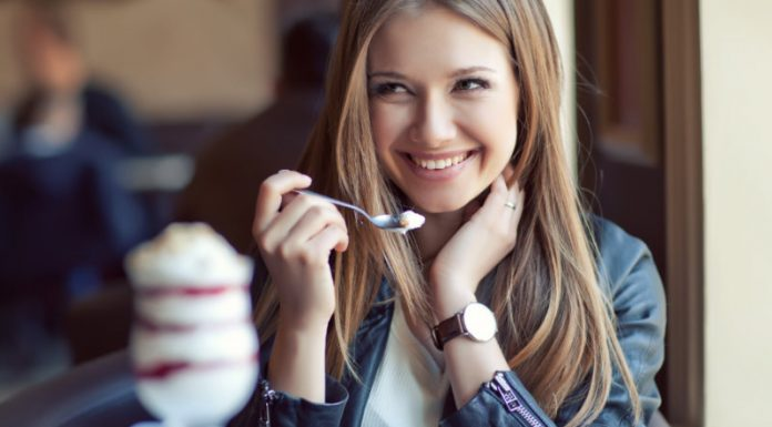 woman eating food and smiling on the french diet