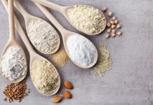 wooden spoons with gluten-free flours and starches
