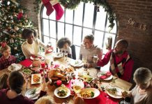 holiday party with guests eating at a dining table