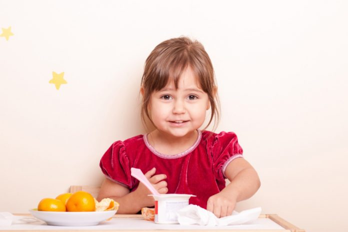 little girl eating low-sugar snack