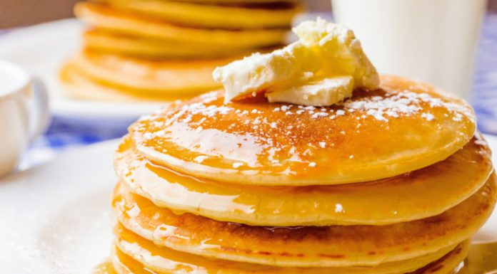stack of grain-free paleo pancakes with maple syrup on top