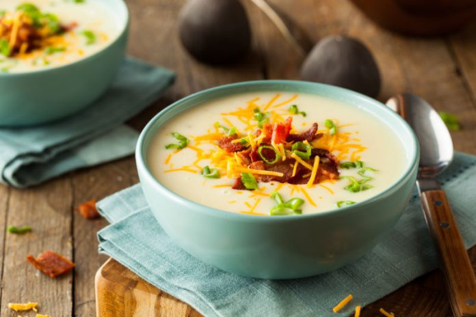 Instant Pot Potato Soup with bacon, cheese, and green onion on top