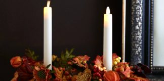 mini pumpkins with candles and flowers
