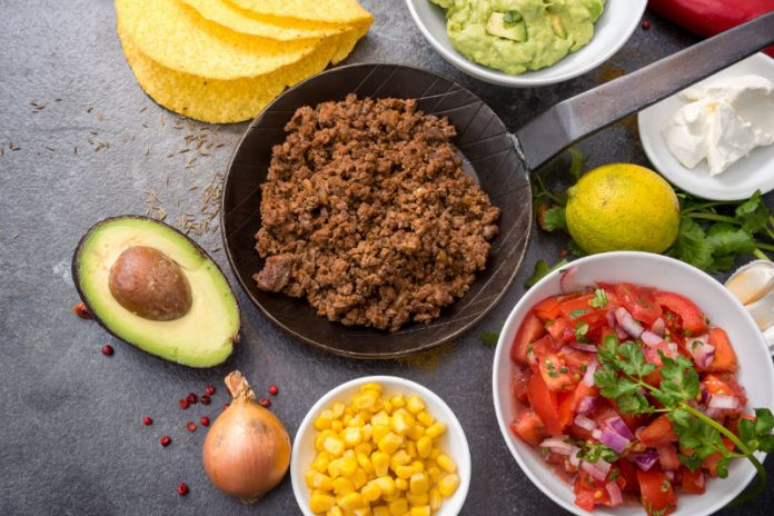 taco casserole ingredients on a kitchen counter